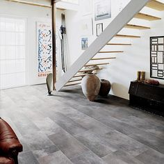 Amazing Tiles Floor Design Application at Home: Cozy Porcelain Tile Creates An Exotic Effect Under The Floating Staircase With Wooden Footings Near White Wall ~ FreeSharing Interior Inspiration Modern Floor Tiles, Modern Flooring, Ceramic Floor Tiles, Porcelain Tiles, Floor Design, Tile Design, House Design, Basement Flooring, Kitchen Flooring