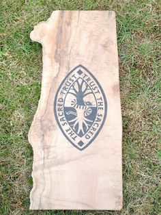 The Sacred Trust hand burnt onto Maple Wood. www.pegasusandcrow.com