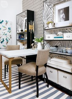 """Patterened den—""""I was hesitant about placing the table at this angle,"""" says Christine of the den's arrangement. """"Now, I love it."""" The striped rug makes the room feel wider than it actually is."""