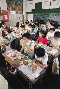 Schoolchildren eating at their desks. Japan