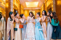 A shimmery Lehenga with ruffles is to die for! Bridesmaid Poses, Bridesmaid Dresses, Wedding Dresses, Bridesmaids, Indian Wedding Planning, Wedding Planning Websites, Girl Hiding Face, Indian Gowns Dresses, Real Couples