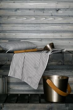 Nice colour scheme—grey with natural wood! Sauna with great bucket and spoon.