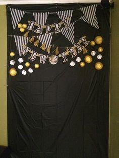 new years eve decorations dollar store decorations for the photo backdrop. used cup cake liners for the dots and made the tassel garland out of tissue paper