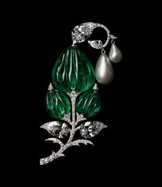 Viren Bhagat Colombian emerald, diamond and natural pearl brooch featuring a 30-carat Mughal carved old-mine Colombian emerald bead. The inspiration stems from the 'Jigha' turban ornaments worn by Indian royalty.