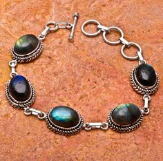 'Natural Labradorite Bracelet' is going up for auction at  9am Tue, Jun 26 with a starting bid of $5.