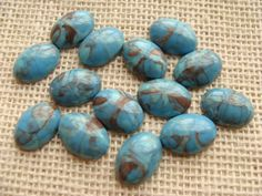 Faux turquoise oval cabochon lot - 18 x 12 mm - quantity of 14 - blue with brown marble swirls