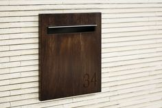 Javi Fence Mount Letterbox - Dark Stained Timber Panel.