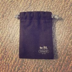 Small brown Coach dust bag Small brown Coach dust bag. Perfect for small pieces of jewelry, like earrings, rings, or bracelets. The measurements are 3.25 inches by 2.5 inches. Drawstring enclosure. In great condition! Coach Accessories