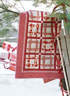 Compose this fresh red-and-white wall hanging with various cheerful prints and a simple Churn Dash block.
