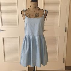 Gap Chambray Dress Adorable Gap chambray spaghetti strap dress. Cute for layering in all seasons and definitely a must have for spring. Size 2. Zips on side. The straps tie into cute little bows which adds a unique touch. Make an offer or bundle to save! GAP Dresses Mini