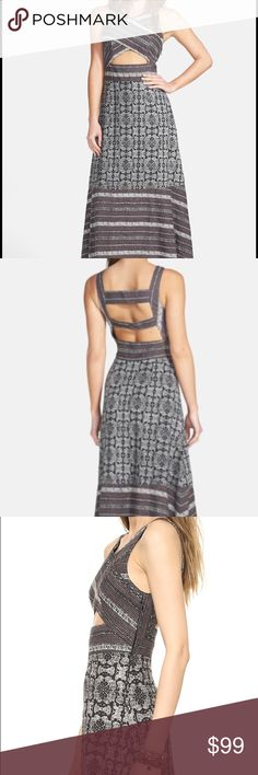 """Free People Tribal Cutout Mixed Print Midi Dress Free People. Skin-baring cutouts emerge from the crossed front and bar-back bodice of a swishy midi dress accented with trend-right mixed prints. - 100% cotton - Machine wash cold, tumble dry low - Approx. 48"""" long, 14"""" across bust, 12.5"""" across waist, 17.5"""" across hips Free People Dresses Midi"""