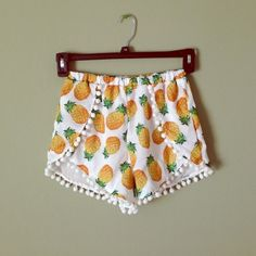 Pineapple Pom Pom Shorts $45 each. ATTENTION: If you would like to buy a pair, I will create a new listing for you! NEW without tags (didn't come with any), adorable pom pom shorts with pineapple print!  I have one pair left in a Small.  Medium and large - please allow two weeks for me to ship as I have to get them from a friend.  They have an elastic waistband with a lot of stretch to it.  I did the ALS ice bucket challenge in my own pair, so I took a screenshot of the video to show what…