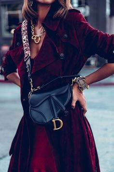 In the Trenches - Dior Jewelry - Ideas of Dior Jewelry - Definitely my favorite bag at the moment Dior saddle bag with a burgundy strap; wore it with a burgundy trench coat and gold jewelry to add a little something extra to the look Rock Chic, Suede Trench Coat, Trench Coats, Cristian Dior, Dior Saddle Bag, Dior Jewelry, Gold Jewelry, Gold Necklaces, Dior Addict