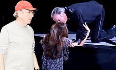 Sweet Caroline! Neil Diamond shocks audience by crouching down to smooch a lucky fan mid-way through performance