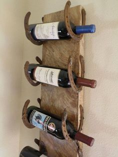 Wine rack from horseshoes and a wood plank! Brilliant!