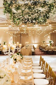 Greenery Branch Canopy above dance floor with roses hanging upside down #wedding #decor