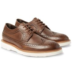 <a href='http://www.mrporter.com/mens/Designers/Tods'>Tod's</a> longwing brogues are equally sturdy and stylish. Expertly made in Italy from chocolate-brown leather, they're traditionally perforated, pinked and finished with medallion toes. The contrasting foam soles give them a sporty edge over more formal styles.