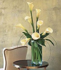 Can anyone please give me a quote for 8 to 10 Calla Lilly centerpieces like this: