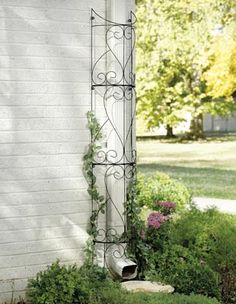 """Circular Outdoor Garden Trellis $17   Conceal downspouts with a clever landscaping illusion. Semicircular trellis wraps around the pipe and provides a trellis for climbing plants. Four easy to assemble metal sections, stands 6-ft. Hardware incl. Assembly required. 71 1/2""""H x 10""""W  on waiting list for availability  12.7.12"""