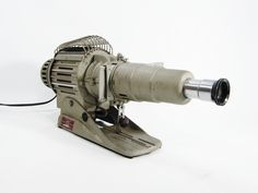 Vintage Slide Projector Space Gun design. $128.00, via Etsy.