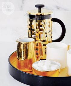 #gold Bodum French press sits inside a gold lined tray (WANT WANT WANT)