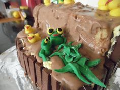 This is an easter cake that i made and it was actually my first ever attempt at sugar paste xxx i love the frogs xx
