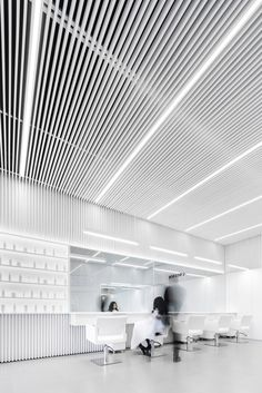 Abraham Cota Paredes creates stark white interior for hair salon in Mexico Linear Lighting, Cool Lighting, Retail Interior, Office Interior Design, Space Interiors, Office Interiors, White Restaurant, Beauty Salon Interior, Corporate Interiors