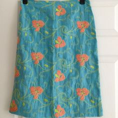 ANTHROPOLOGIE Tocca embroidered skirt Beautiful  aquamarine linen-blend skirt with chartreuse and coral embroidery! Great needlework on this fabulous skirt! Pre-loved..in good condition Anthropologie Skirts