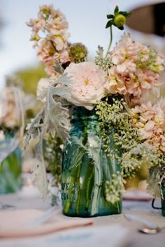 Beautiful flower arrangement in a Mason Jar. Recreate with our Mason Jar rentals for your wedding, birthday party or other special occasion www.mtbeventrentals.com | www.instagram.com/mtbeventrentals