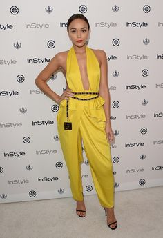 Ashley Madekwe showed skin risqué yellow jumpsuit