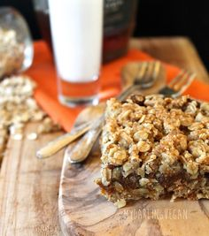 Sweet pumpkin filling baked between layers of almond oatmeal crumble for delicious and seasonal vegan and gluten-free Pumpkin Date Bars