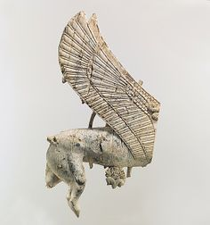 Plaque with hindquarters of a sphinx    Period:      Neo-Assyrian  Date:      ca. 9th–8th century B.C.  Geography:      Mesopotamia, Nimrud (ancient Kalhu)  Culture:      Assyrian  Medium:      Ivory