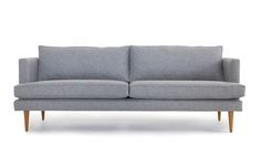Effortlessly simply and sophisticated, this sofa brings a little handcrafted, custom mid-century charm to any space.