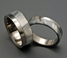 """Very Masculine """"Smoke and Mirrors"""" (Edged by a highly buffed and polished band of titanium, this ring is offset with a smokey and beautiful gray and white marbled inlay.)"""