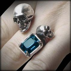 The bones of mortality nestle amidst the bright crystal of immortality. Death lingers in all corners where life continues, and its touch extends to every facet. A Spati ring occupies the gaps between the fingers, leaving the Alchemy Gothic skull and crystal free to spread their message.