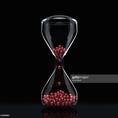 Foto stock : Hourglass filled with balls