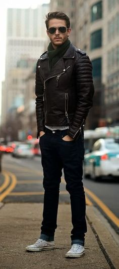leather biker jacket / dark blue jeans / white low-top chucks / scarf tied in a classic loop / sunglasses
