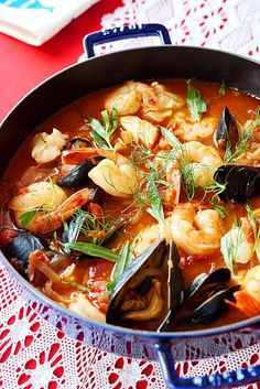 Transfer the stew to a large bowl, or serve it in a pot, right on the table. Sprinkle with those fennel fronds (if you have 'em), or just the leaves of tarragon. | How To Make A Seafood Stew To Warm Every Heart