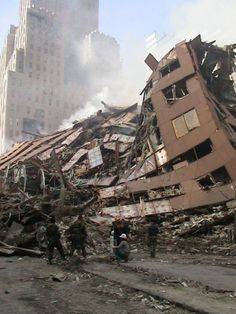 POST COLLAPSE WTC 7. Military at rubble with plastic bags. 11 September 2001, Ufo Footage, World Trade Center Nyc, Psychological Warfare, We Will Never Forget, Alien Planet, Living In New York, Space Crafts, Natural Disasters