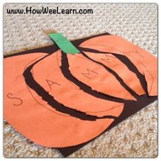 Pumpkin Name Puzzles are perfect Halloween Crafts to help wee ones learn their names and practice cutting and gluing.