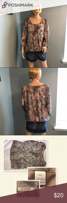 """Roz & Ali Blouse Has shimmer thread throughout making this shirt really beautiful. The bottom hem is elastic so that it helps create a """"flowy"""" look for the shirt. roz & ali Tops Blouses"""