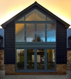 """This project from @timbermasterltd is a perfect example of the growing trend of homes that bring the outdoors in - """"We love working on big projects and this one was no different - this barn conversion in Buckinghamshire needed new bifold doors, French doors and a gable end window. We built the massive Accoya wood framework and added double glazing to produce this stunning glazed gable so the clients can make the most of their views and let the light flood in."""" Grey Exterior, Grand Designs, Old Building, Facades, Cladding, French Doors, New England, Modern Farmhouse, Bungalow"""