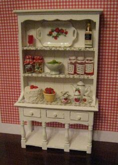 Filled Hutch, Strawberry themed.   Twelfh scale dollhouse miniature. $34.50, via Etsy.