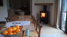 Contura wood-burning stove in a corner fireplace.