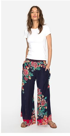 For a bold and elegant look, these Rosey Pants are a great option. They have a bold floral design and a vibrant color pattern to enjoy. Pair with a simple T-shirt for a lovely look. They are designed to almost brush the ground and flare out from the hip Boho Style Dresses, Boho Dress, Bohemian Style, Boho Chic, Gorgeous Fabrics, Resort Style, Cowgirl Style, Pull On Pants, Johnny Was
