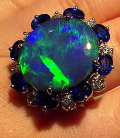Detail: An opal, sapphire, and diamond ring by Oscar Heyman. Via Diamonds in the Library.