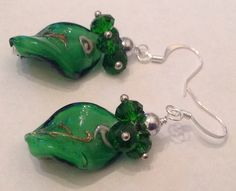 Green wavy lampwork beads with green crystal cluster and silver accents. Www.facebook.com/CraftsbyBnB