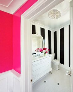 Black & white walls, crystal light fixtures, pink contrast  Hot Pink Decor Inspiration /// By Design Fixation