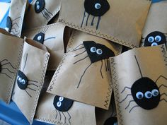 chubbs (my 4 year old) and I made treat bags for his class.  Eco-friendly too - they are made of brown grocery bags and sewed up the sides.  We used scraps of felt leftover from my pillowhead.etsy.com stuff for the spider's bodies, and drew the legs on with marker.  The only thing I had to buy was the googly eyes.  My favourite is the triangular spider that he cut out.  I had to help with the ovals.  Also like the one eyed and three eyed spiders. :)