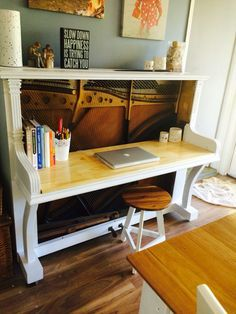 Piano Reno to desk. Too sad to send this 130 year old piano to the tip after it was given the death sentence by our piano tuner. Now it is a fabulous desk with exposed strings.